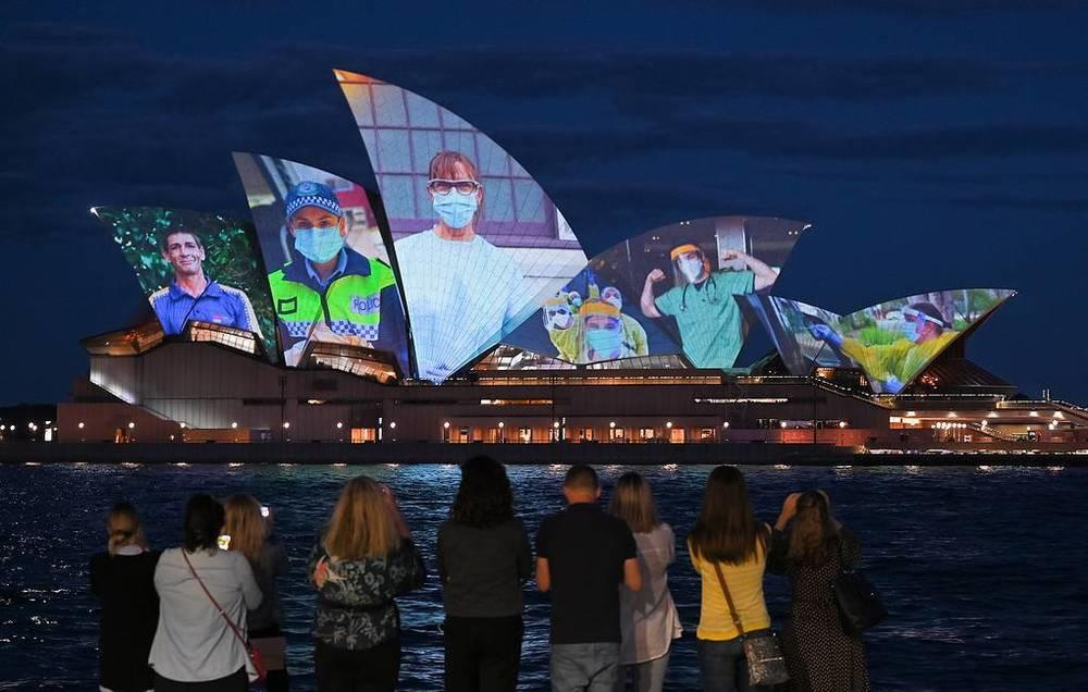 This week in photos: Peresild's return from ISS, chapel disinfection, McGregor's waxwork. Images | The Sydney Opera House is illuminated with photographs of health workers and vaccinated citizens to celebrate the vaccination threshold of 80% of NSW's population, Sydney, October 18. The region is now moving towards easing coronavirus restrictions, after nearly four months of lockdown | tass.com