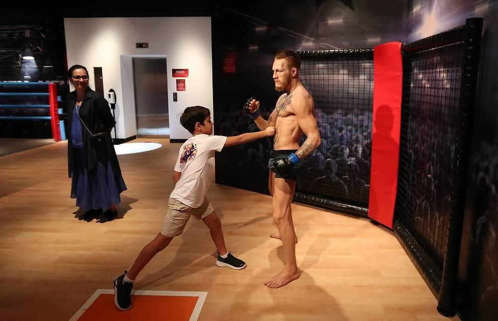 This week in photos: Peresild's return from ISS, chapel disinfection, McGregor's waxwork. Images | Visitors next to the wax figure of the Irish MMA master Conor McGregor at Madame Tussauds Wax Museum in Dubai, October 18. It now houses 60 wax figures from sports, music, cinema and politics, and is the first branch of the museum in the Arab world | tass.com