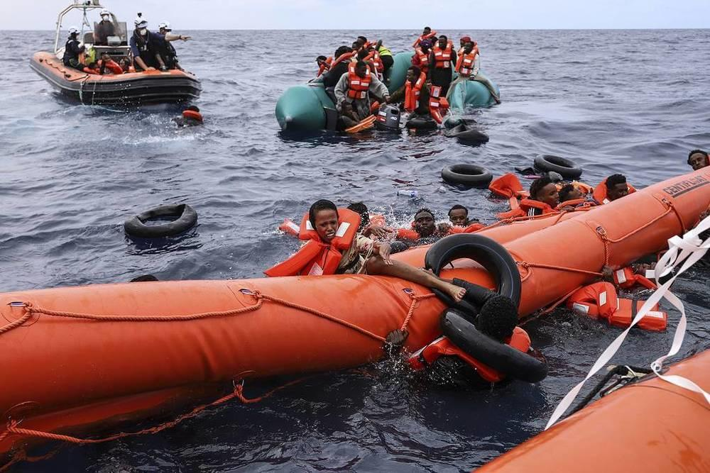 This week in photos: Peresild's return from ISS, chapel disinfection, McGregor's waxwork. Images | Migrants aboard a rubber boat, where they were found and rescued by members of the Sea Watch-3 charity ship crew, about 56 kilometers from Libya, October 18 | tass.com